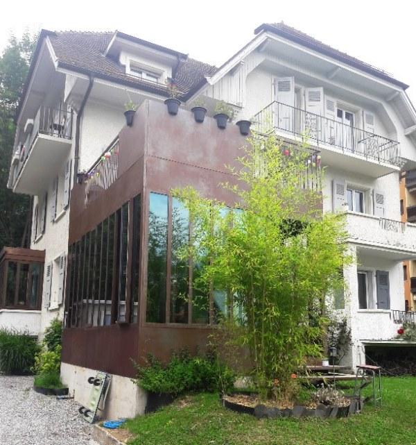 Création d'une pièce à vivre avec un toit terrasse